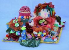 Handmade centerpiece featuring miniature cupcake.